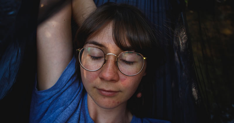Woman sleeping in a hammock