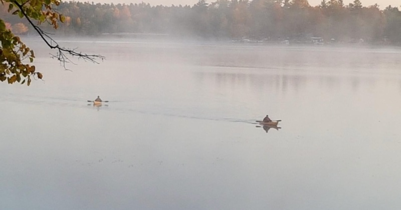 paddlers in the morning mist